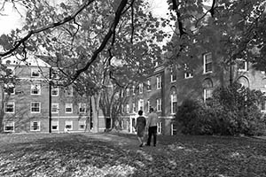 South side of Congreve Hall in autumn with two people walking on walkway.
