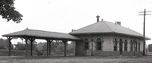 Dairy Bar and railroad station, taken by Clement Moran ca. 1917.