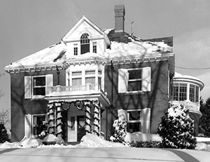 President's House covered in snow and decorated with garlands, December 1960.