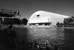 Snively Arena with outdoor pool in the foreground, ca. 1965.