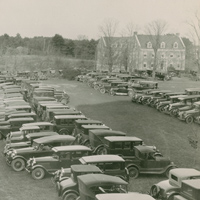 Cars in front of DeMeritt Hall
