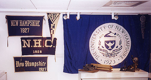 Collection of UNH banners hanging on wall
