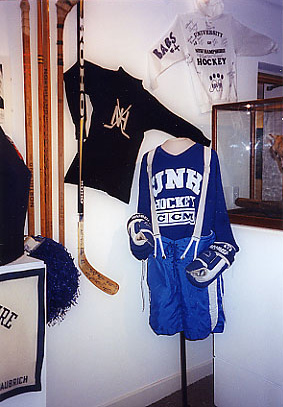 UNH hockey sticks and uniform on display