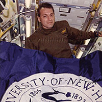 UNH Flag in space shuttle with astronaut Richard Linnehan