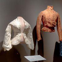 women's vintage blouses and tops on display in the museum