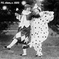 P.E. class, two women dancing in clown costume
