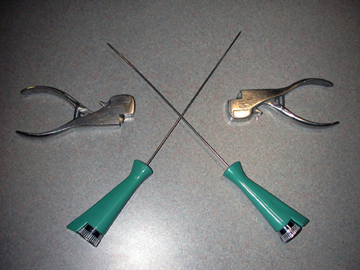 Two metal skewers and punch tools