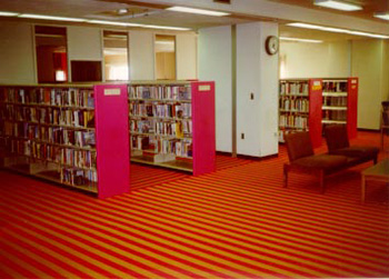 Interior of Dimond Library, circa 1970, with bold striped carpet
