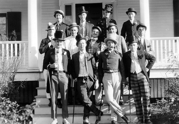 Group of students pose in top hats and tails