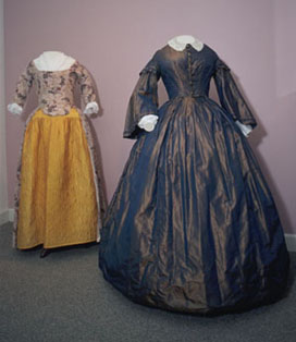 Yellow dress (left) and silk blue dress (right) on display