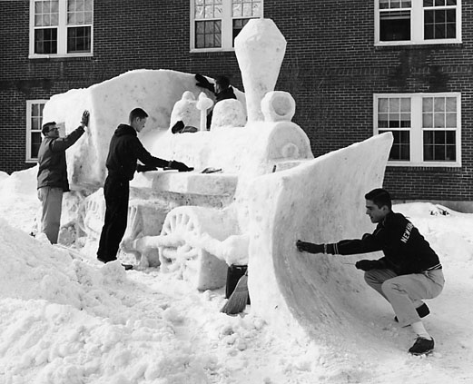 Students create a train engine snow sculpture