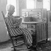 Old Shaker woman in rocking chair